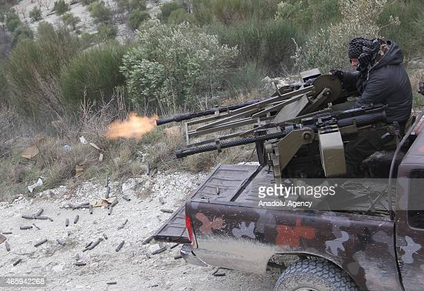 Syrian opposition members launch an attack during an operation against Assad regime forces in 'Kurd Mountain' region in Latakia Syria on March 12 2015