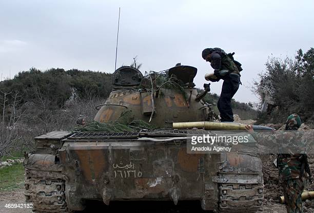 Syrian opposition members make preparations ahead of attacks against Assad regime forces in 'Kurd Mountain' region in Latakia Syria on March 12 2015