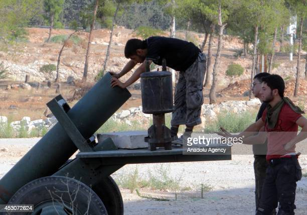 Syrian opposition Mujahidin Brigade members stage attacks to Military Academy with Grad rockets and howitzers made up by propane cylinder and named...
