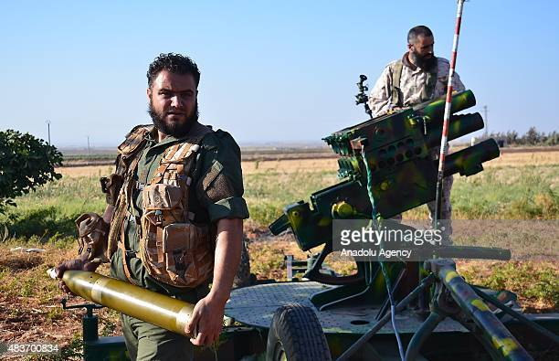 Syrian oppositions linked to Damascus Front prepare rockets to fire them southeast of Mari district Um Hos village where is under the control of...