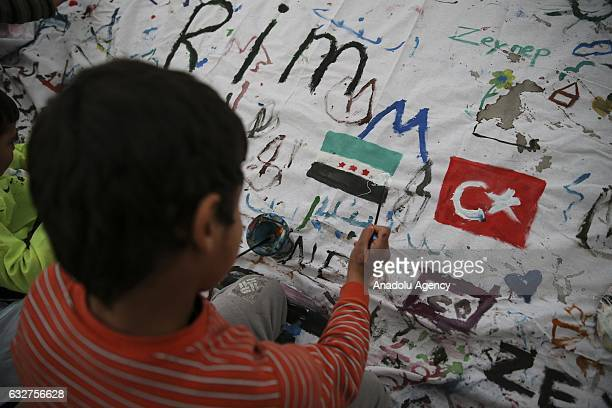 Syrian orphan kid paints at Bahattin Yildiz Orphanage in Reyhanli district of Hatay Turkey on January 26 2017 25 students from different universities...