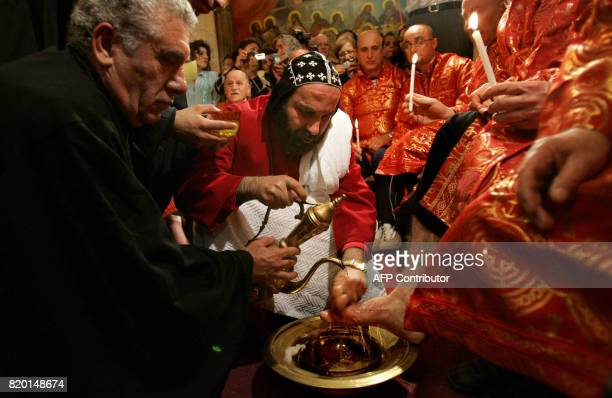 Syrian Orthodox Archbishop, Severias Meliki Morad, conducts the traditional Washing of the Feet ceremony at St. Mark's Church in Jerusalem's Old...