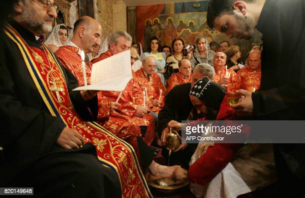 Syrian Orthodox Archbishop Severias Meliki Morad conducts the traditional Washing of the Feet ceremony at St Mark's Church in Jerusalem's Old City 20...