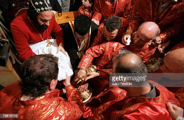 Syrian Orthodox priests wash the feet of Archbishop Severias Meliki Morad during the traditional Washing of the Feet ceremony at the St Marks Syrian...