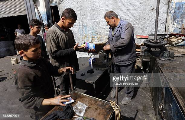 Syrian Othman alNajjar and his brother Rashed work at a mechanic shop which is located underneath a room they live in with the rest of their family...