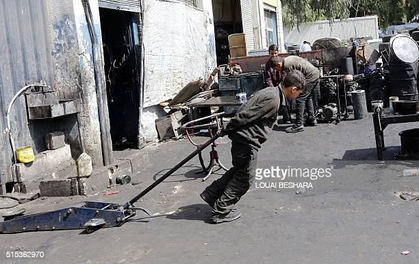 Syrian Othman alNajjar works at a mechanic shop which is located underneath a room he lives in with the rest of their family members in the capital...