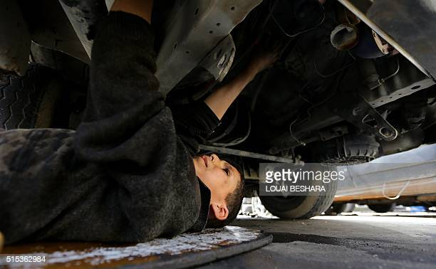 TOPSHOT Syrian Othman alNajjar works at a mechanic shop which is located underneath a room he lives in with the rest of their family members in the...