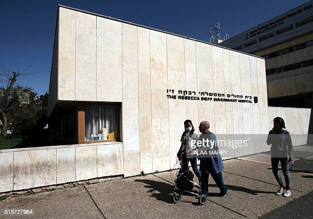 A Syrian patient who was wounded in the ongoing conflict in Syria walks outside The Rebecca Sieff Government Hospital also known as the Ziv Hospital...