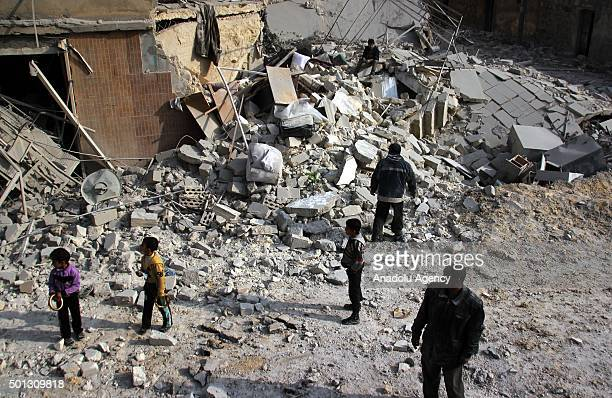 Syrian people are seen among the wreckage of buildings after Russian army attacked residential areas of Merce neighborhood of Aleppo Syria on...