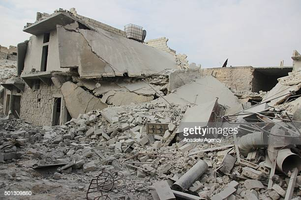 Syrian people are seen among the wreckage of buildings after Russian army attacked residential areas of Merce neighborhood of Aleppo, Syria on...