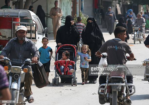 Syrian people are seen in Jarabulus District of Aleppo Syria after the area is being freed from Daesh terrorists during the Operation Euphrates...
