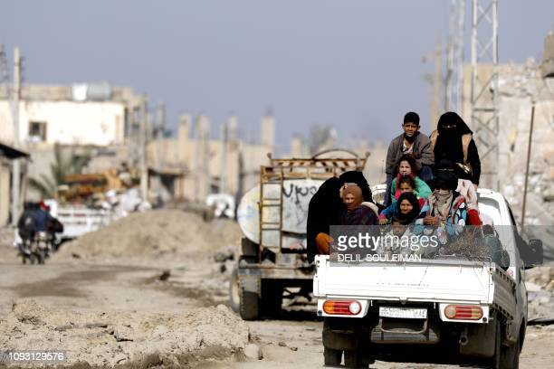 Syrian people return to their homes after the area was freed from IS group members in Hajin on February 2 2019 Backed by a USled coalition the SDF...