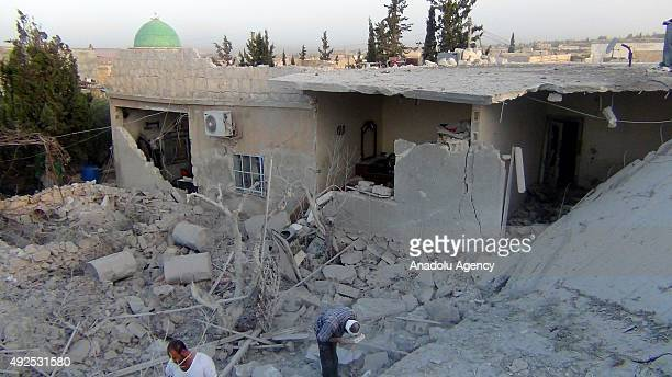 Syrian people search for the air attack victims after Russian war crafts hit the Syrian opposition controlled town Hayan in Aleppo Syria on October...