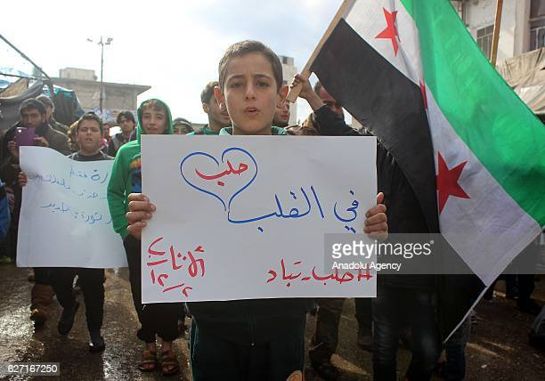 Syrian people take part in a protest against Assad Regime and Russian airstrikes over civilian people and residential areas of Aleppo at Etarib...