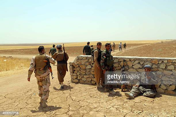 Syrian People's Protection Units members and Kurdish Peshmerga forces fight against Islamic State of Iraq and the Levant in Mahmudiye village Mosul...