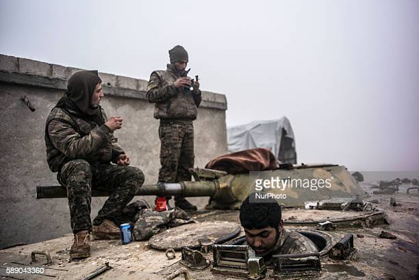 Syrian People's Protection Units members sit in a tank in frontline of Raqqa on January 7 2016 YPG fight against the Daesh to liberate the city of...