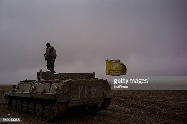 Syrian People's Protection Units on a tank in frontline of Raqqa fights against Daesh on January 1 2016