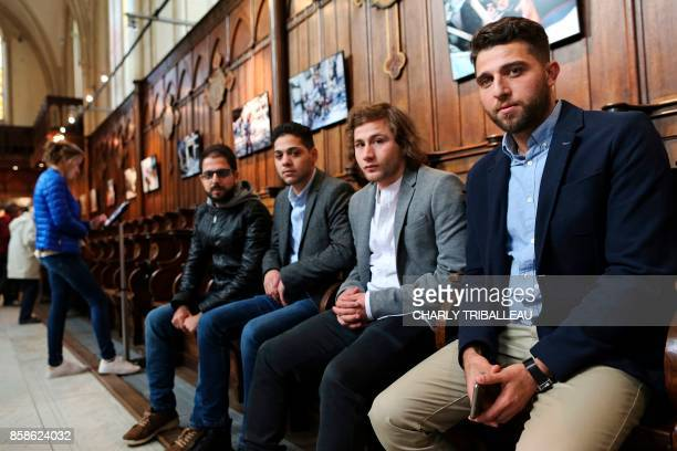 Syrian photographers working for AFP Karam alMassri Baraa AlHalabi Ameer Alhalbi and Zakaria Abdelkafi pose during a photography exhibition in Bayeux...