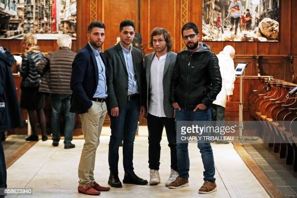 Syrian photographers working for AFP Zakaria Abdelkafi Baraa AlHalabi Ameer Alhalbi and Karam alMassri pose during a photography exhibition in Bayeux...