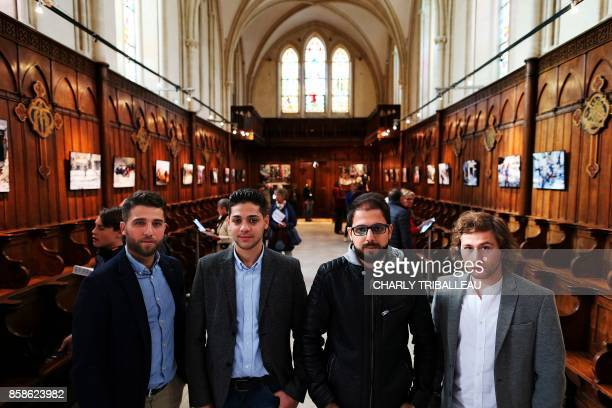 Syrian photographers working for AFP Zakaria Abdelkafi Baraa AlHalabi Karam alMassri and Ameer Alhalbi pose during a photography exhibition in Bayeux...