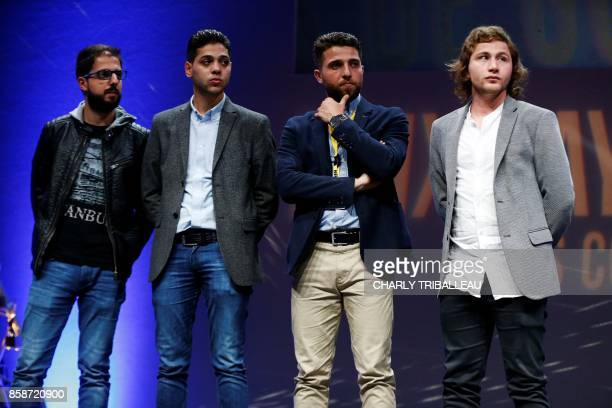 Syrian photographers working for Agence France Presse Karam alMassri Baraa AlHalabi Zakaria Abdelkafi and Ameer Alhalbi attend the closing ceremony...
