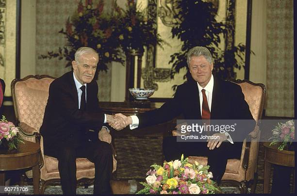 Syrian Pres Hafez al Assad shaking hands w US Pres Bill Clinton during mtg in effort to advance stalled Syrian/Israeli peace process