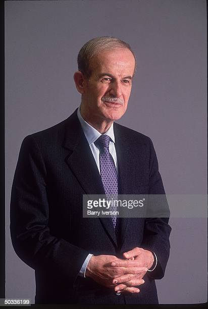Syrian Pres Hafez Assad in affable portrait during TIME interview
