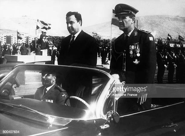 Syrian president and Prime Minister Nureddin al-Atassi and Syrian General Hafez al-Assad on a review of the troops on March 8, 1967 in Damascus,...