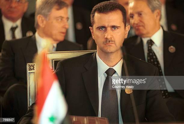 Syrian President Bashar Al Assad sits at a desk at the Arab Summit March 27 2002 in Beirut Lebanon Saudi Crown Prince Abdullah Bin Abdul Aziz has...