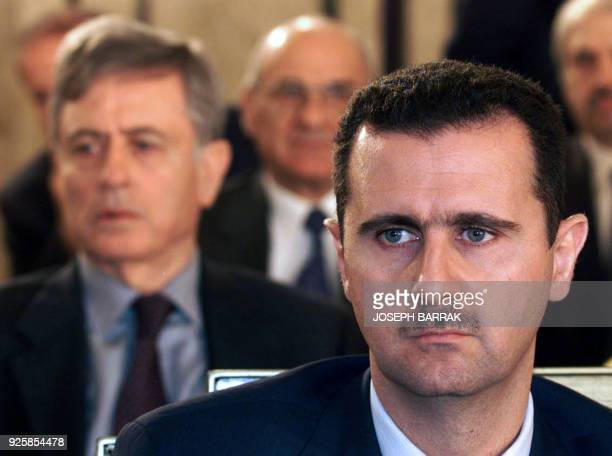 Syrian President Bashar alAssad and former vicepresident Abdel halim Khaddam attend the closing session of the Arab summit in Beirut 28 March 2002...