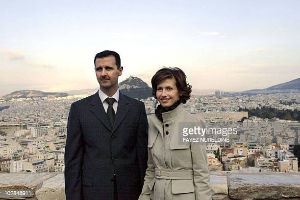 Syrian President Bashar alAssad and his wife Asma pose for photographers during their visit to Acropolis archaeolgical site in downtown Athens 15...