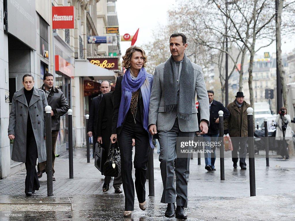 Syrian President Bashar Al Ad And His Wife Asma Walk In A Street Of Paris