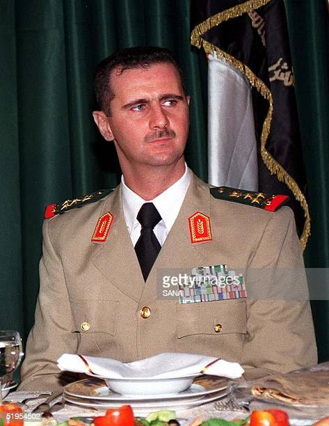 Syrian President Bashar alAssad attends a dinner in Damascus late 01 August 2000 during a ceremony marking the Army Day