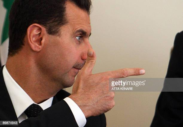 Syrian President Bashar alAssad gestures as he meets with his Iranian counterpart Mahmoud Ahmadinejad in Tehran on August 19 2009 Assad arrived in...