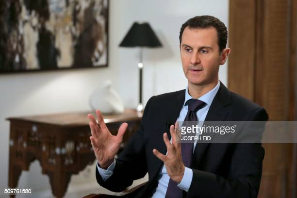TOPSHOT Syrian President Bashar alAssad gestures during an exclusive interview with AFP in the capital Damascus on February 11 2016 / AFP / JOSEPH EID