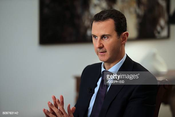 Syrian President Bashar alAssad gestures during an exclusive interview with AFP in the capital Damascus on February 11 2016 / AFP / JOSEPH EID