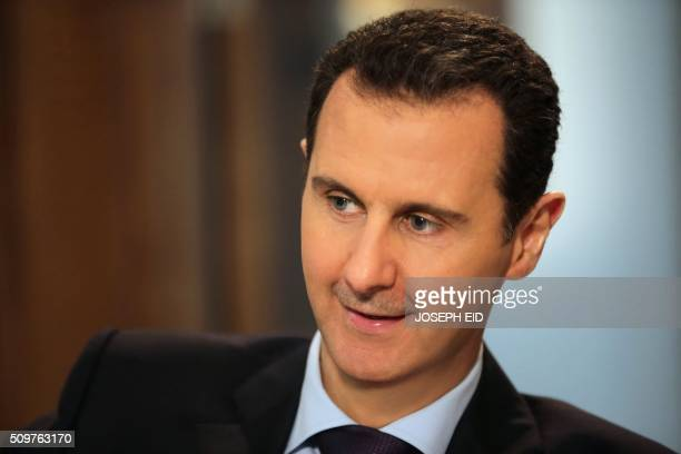 Syrian President Bashar alAssad gives an exclusive interview to AFP in the capital Damascus on February 11 2016 / AFP PHOTO / JOSEPH EID