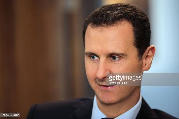 Syrian President Bashar alAssad listens to a question during an exclusive interview with AFP in the capital Damascus on February 11 2016 / AFP /...