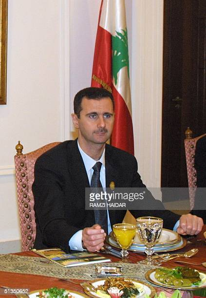 Syrian President Bashar alAssad looks across the table at the start of a dinner given in honor of the leaders attending the Arab summit at the Baabda...