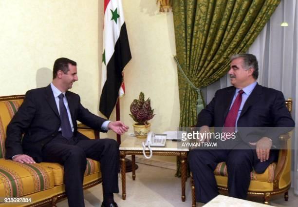 Syrian President Bashar alAssad meets with Lebanese Prime Minister Rafic Hariri in Doha 11 November 2000 The two leaders are in the Qatari capital to...