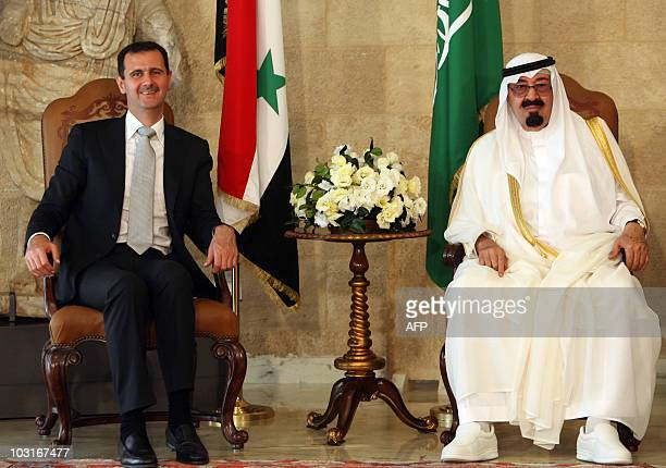 Syrian President Bashar alAssad sits along side Saudi Arabia's King Abdullah and Lebanese President Michel Sleiman prior to their meeting at the...