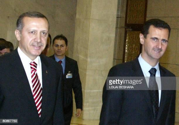 Syrian President Bashar al-Assad walks along side Turkish Prime Minister Recep Tayyip Erdogan at al-Shaab palace in Damascus on April 26, 2008....