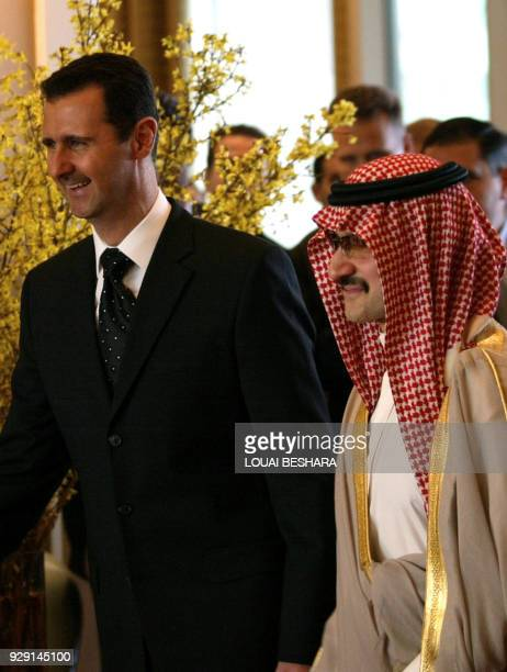 Syrian President Bashar alAssad walks with Saudi Prince alWaleed bin Talal bin Abdulaziz during an inauguration ceremony for Damascus' first Four...