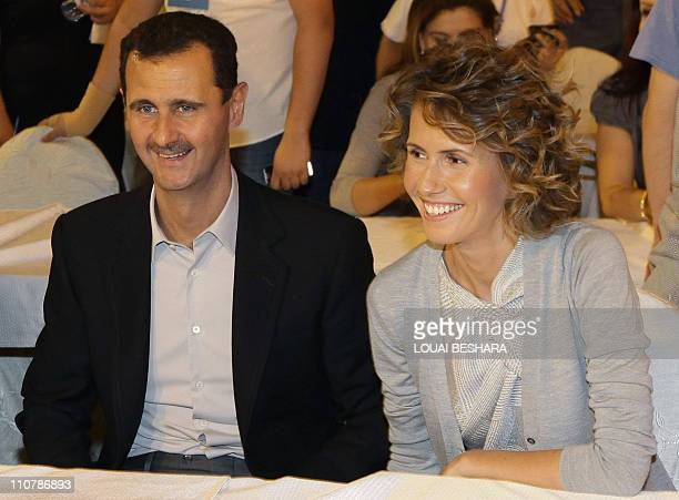 Syrian President Bashar Assad and his wife Asma visit a group of young athletes of special needs gathered at a hotel in Damascus late on September 5...