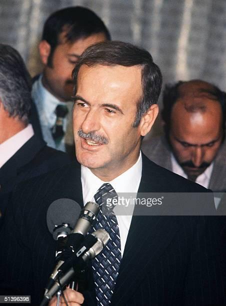 Syrian President Hafez al-Assad addresses media 28 November 1977 during his visit to France. Hafez al-Assad died 10 June 2000 of a heart attack in...