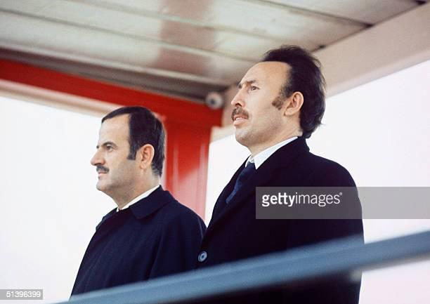Syrian President Hafez alAssad and Algerian counterpart Houari Boumediene listen in November 1973 to the national anthems upon alAssad landing in...