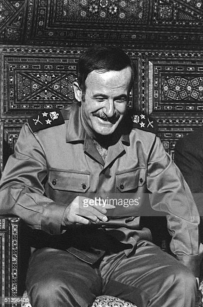 Syrian President Hafez al-Assad drinks a cup of coffee 27 October 1973 after a prayer in the Omayyad Mosque in Damascus. Hafez al-Assad died 10 June...