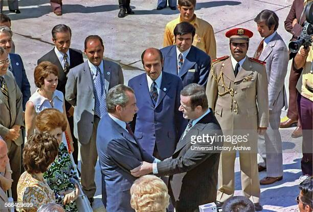 Syrian president Hafez alAssad greets US President Richard Nixon on his arrival at Damascus airport in 1974