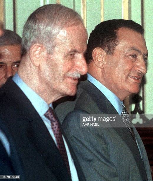 Syrian President Hafez al-Assad walks with Egyptian President Hosni Mubarak at the end of their meeting 26 July in Alexandria. The two presidents met...