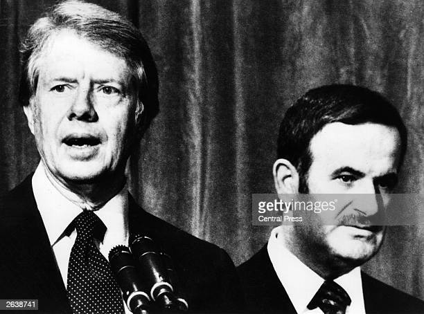 Syrian president Hafez alAssad with American president Jimmy Carter in Geneva for talks on the Middle East Original Publication People Disc HE0226